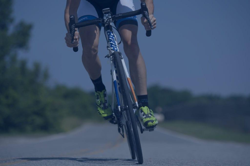 cyclist riding bike on road